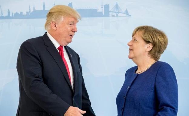 Donald Trump y Angela Merkel.